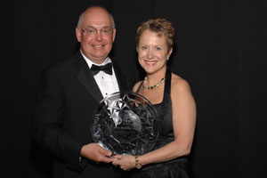 Teri and Bill Popp receiving the 2008 Starkey Hearing Foundation Humanitarian Award