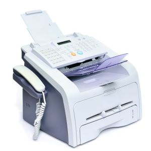 A fax machine connected to POPP analog device adaptor on Cloud PBX Phone System